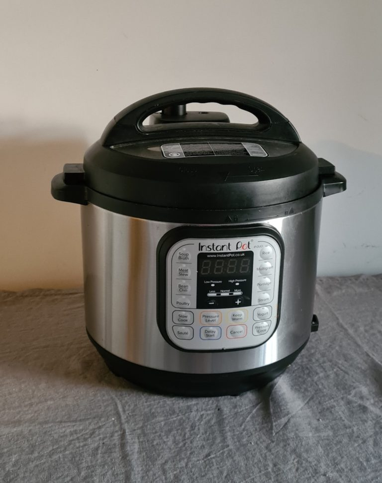 a silver and black instant pot