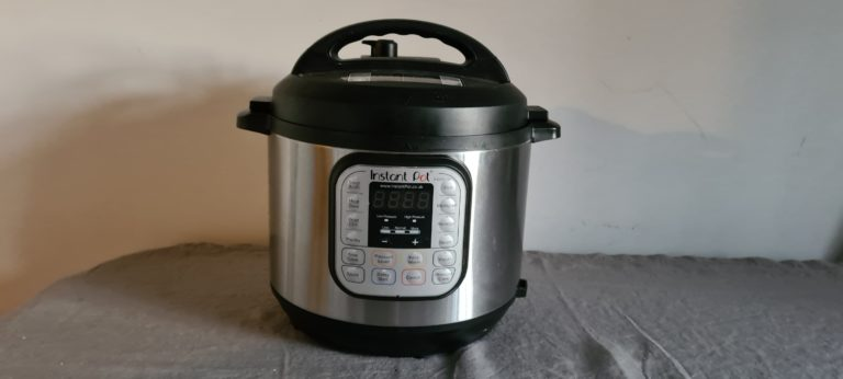 One Instant Pot sitting on a tabletop