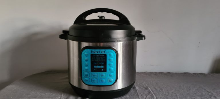 horizontal photo of an Instant Pot sitting on a table