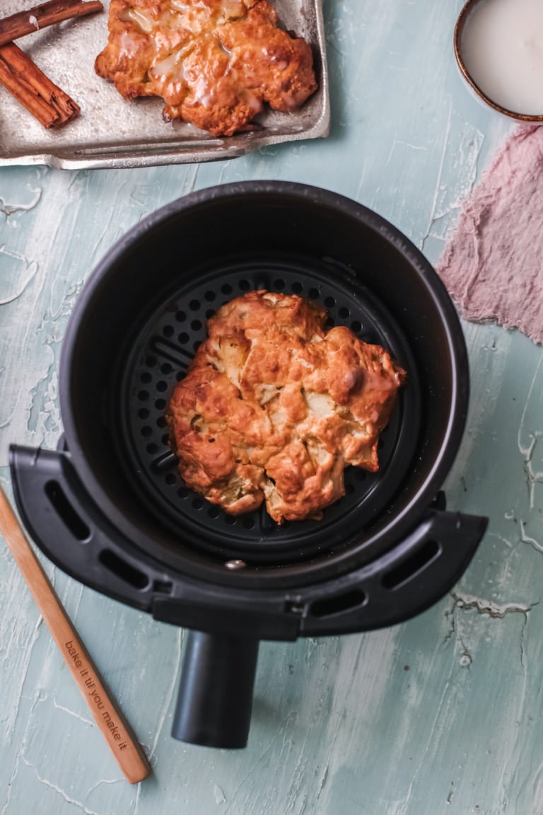 one cooked fritter inside the air fryer basket