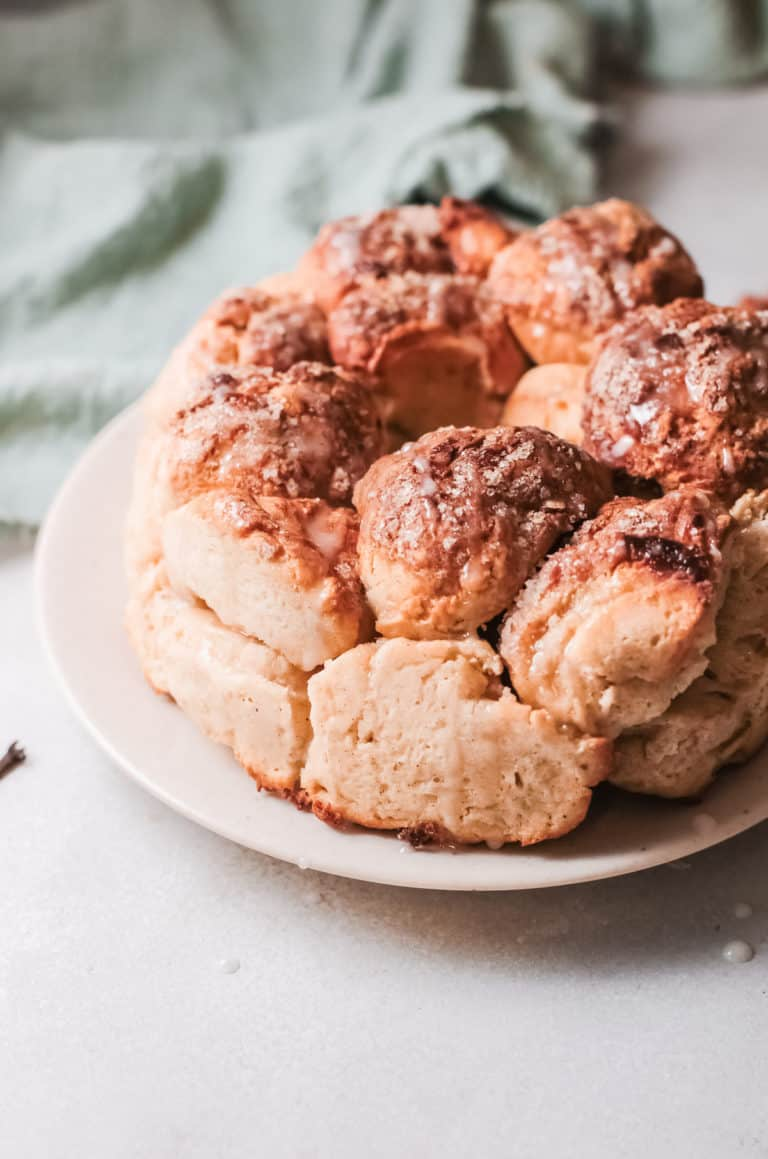 a close up view of the completed monkey bread served on a white plate