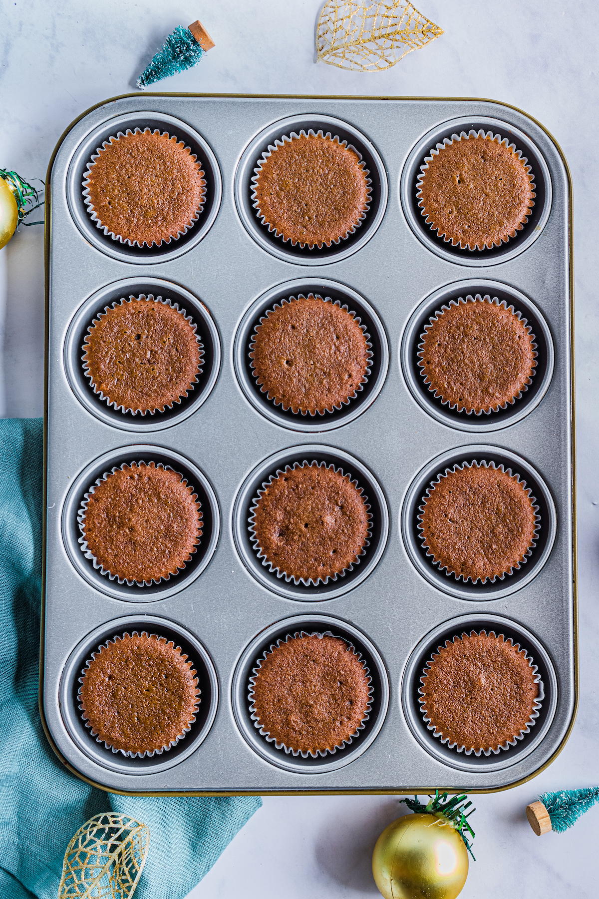 top down view of the cooked gingerbread cupcakes inside the baking pan