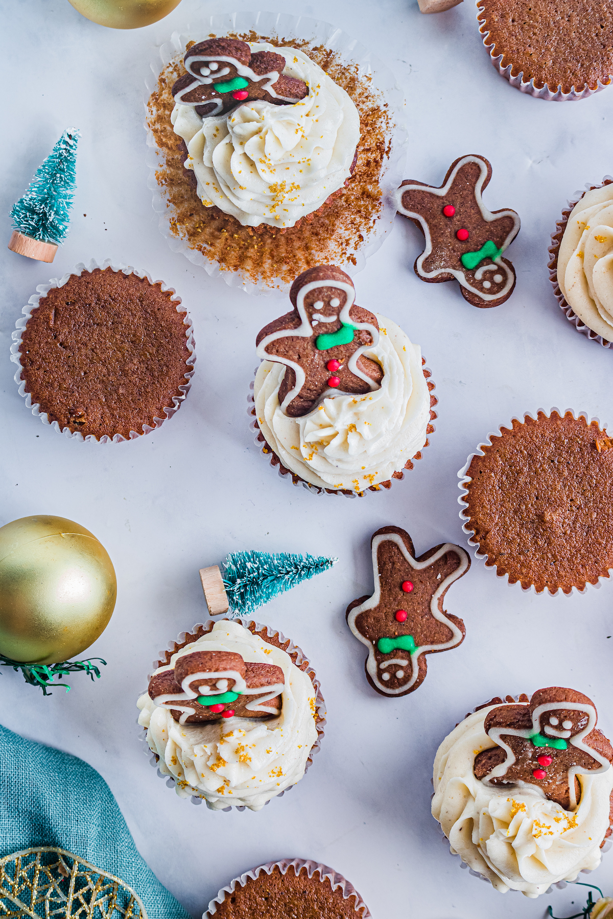 top down view of ginger cupcakes and christmas decor set out on a tabletop