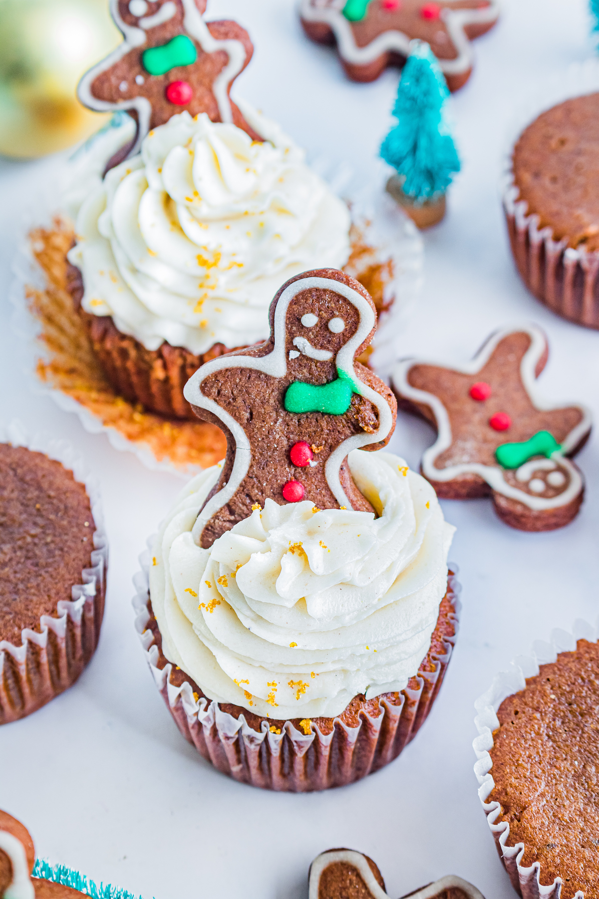 decorated gingerbread cupcakes on a table