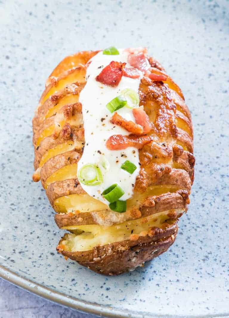 Close-up of one Loaded Hasselback Potato ready to be served