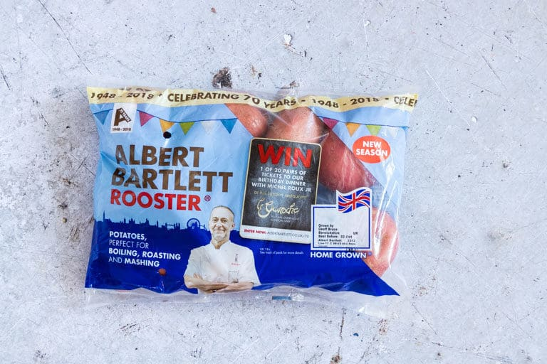 a package of Albert Bartlett Rooster potatoes set on a countertop