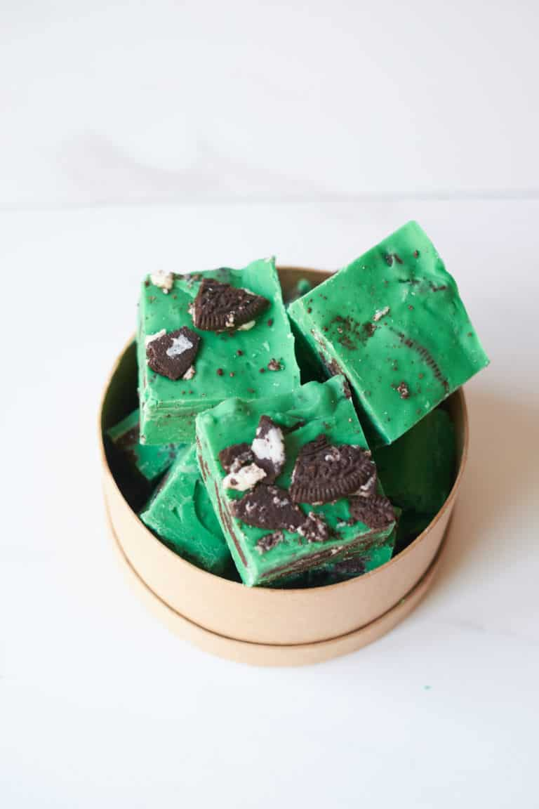 top down view of mint oreo fudge squared packed in a container