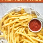 A PLATE OF FRENCH FRIES WITH A SIDE OF KETCHUP