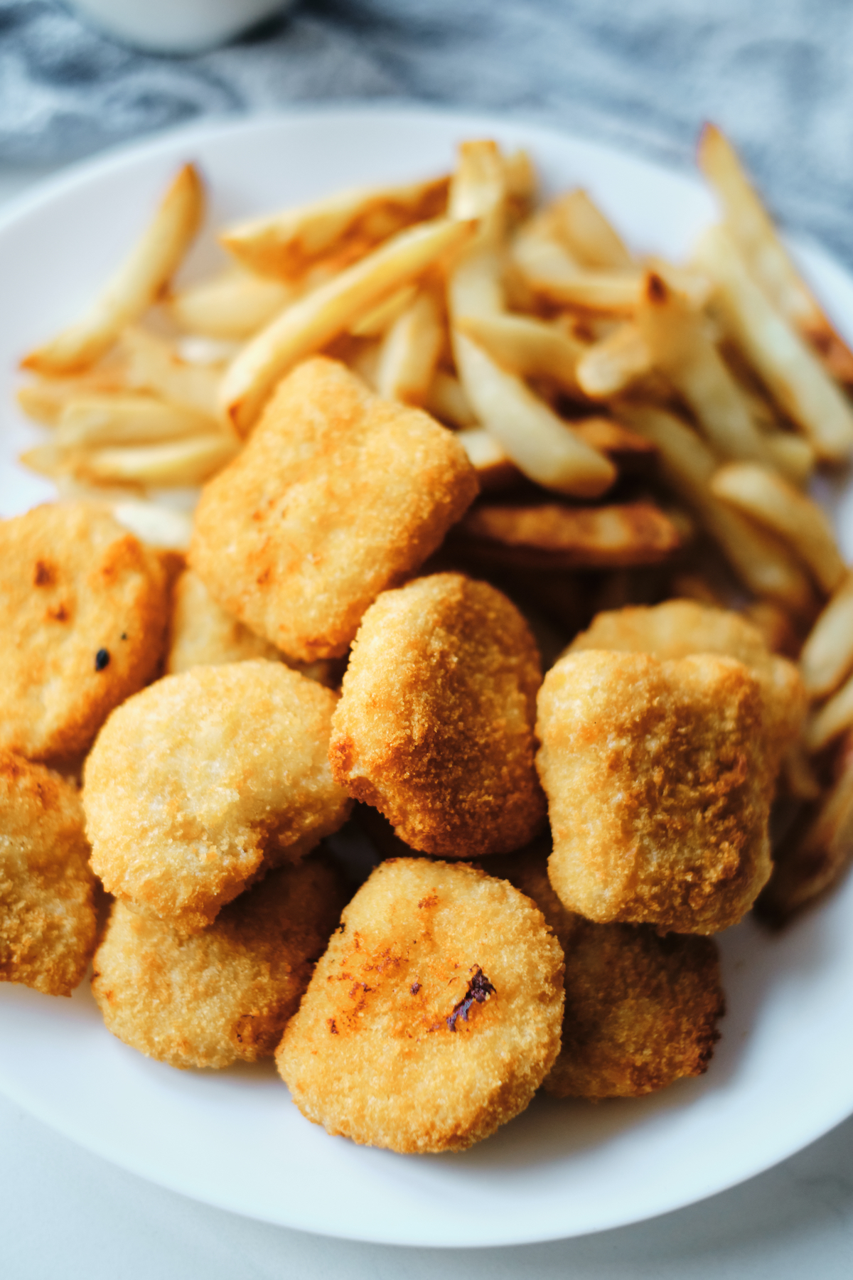 a plate of chicken nuggets and french fries