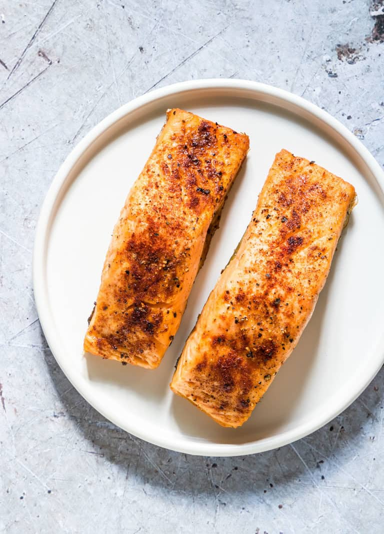 Two cooked Air Fryer Salmon fillets on a plate