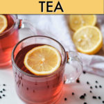 A GLASS MUG OF ELDERBERRY TEA WITH LEMON