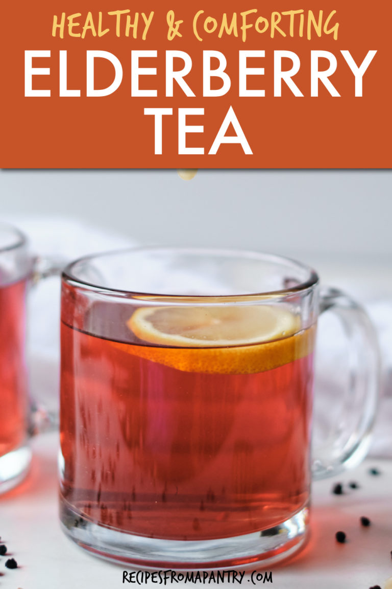 A GLASS MUG OF ELDERBERRY TEA WITH LEMON
