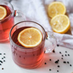 two cups of elderberry tea with lemon slices