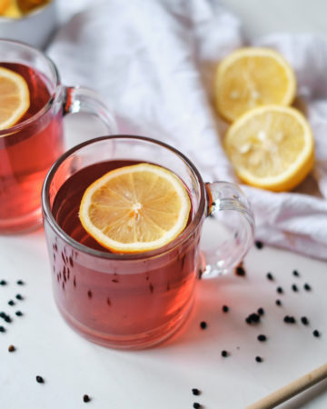 two cups of elderberry tea with lemon slices