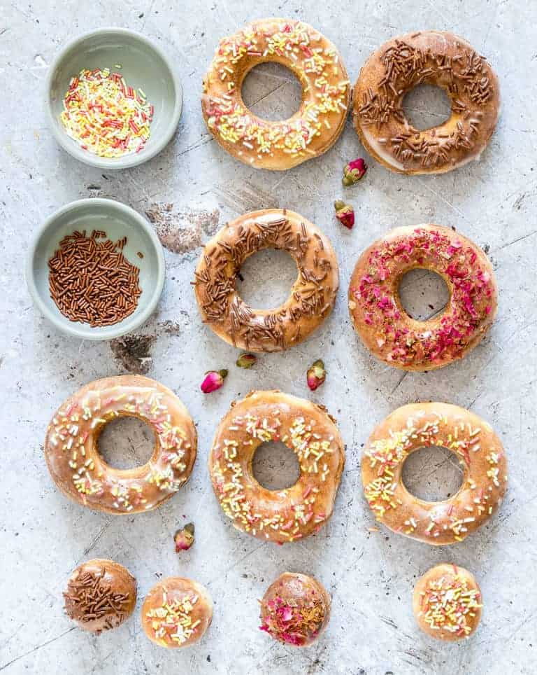 a selection of air fryer donuts decorated with icing and sprinkls