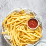 a plate filled with cooked air fryer frozen french fries