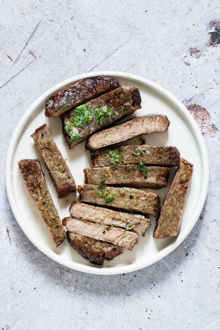 sliced air fryer steak on a plate