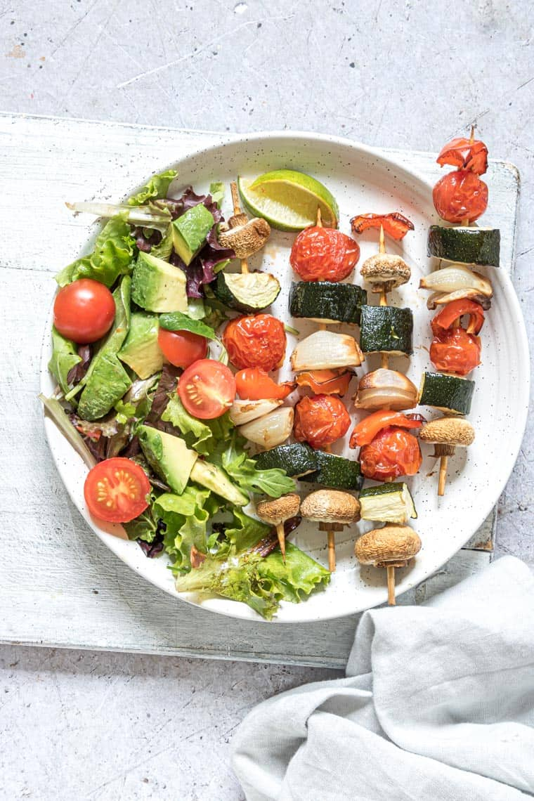 air fryer vegetable kabobs served with a side of green salad