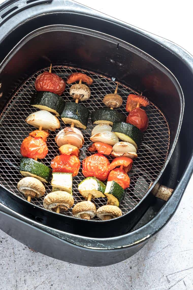 cooked air fryer vegetable kabobs inside the air fryer basket