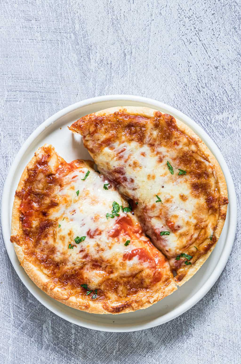 Air Fryer frozen pizza that has been cooked in an air fryer ready to serve