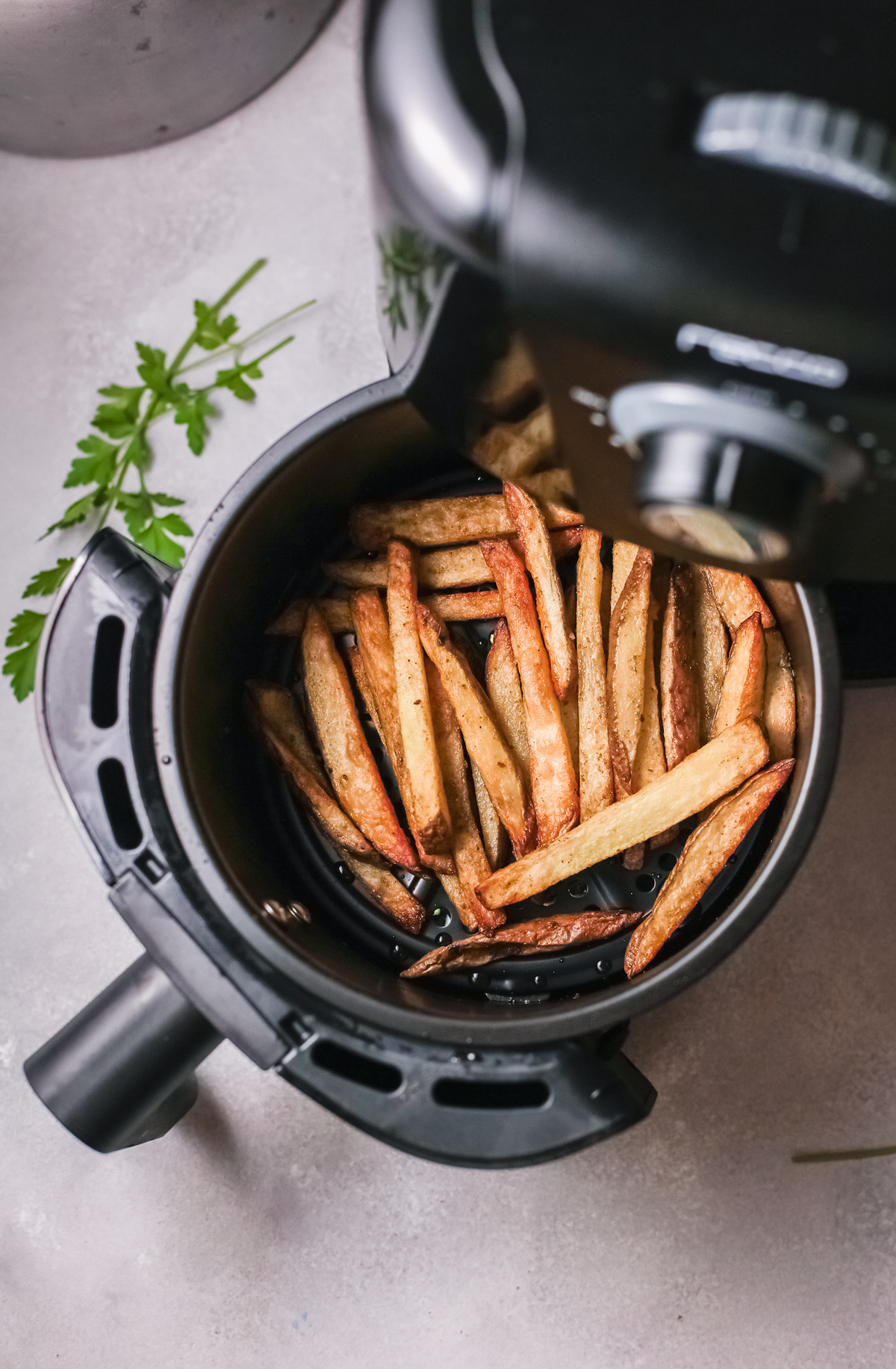 top down view of the cooked fries inside the air fryer basket