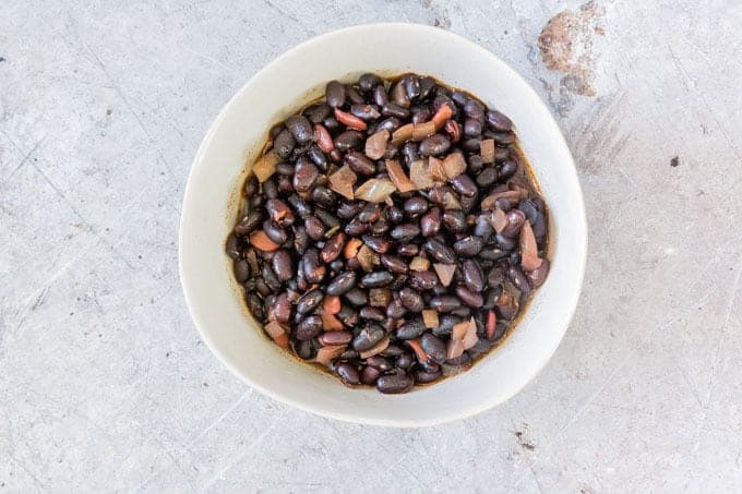 Completed Instant Pot Black Beans served in a white ceramic bowl