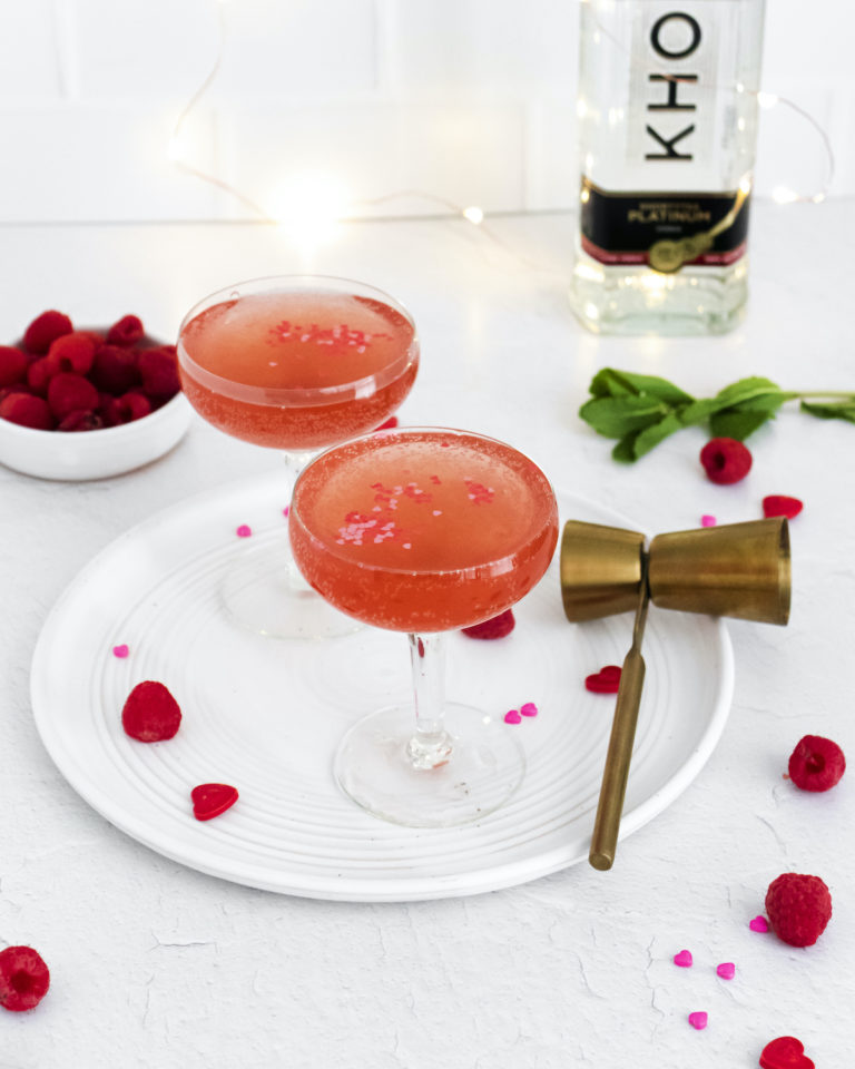 the tools and garnishes needed to make this rose spritzer cocktail recipe