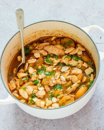 spiced turkey stew in a pot garnished with almonds