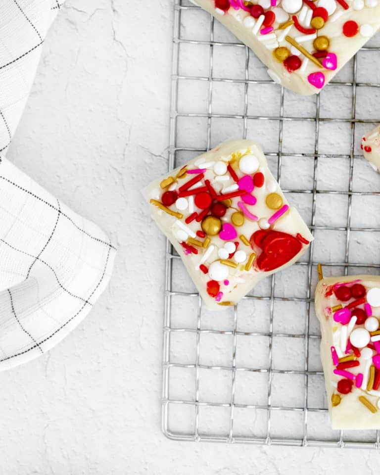pieces of the completed white fudge set on a baking rack