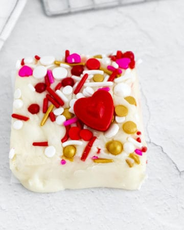 one square of white chocolate fudge decorated with Valentine's sprinkles
