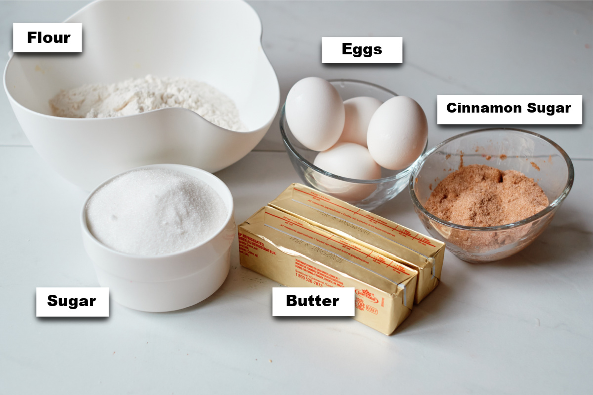 the ingredients for making churro cupcakes with strawberry frosting