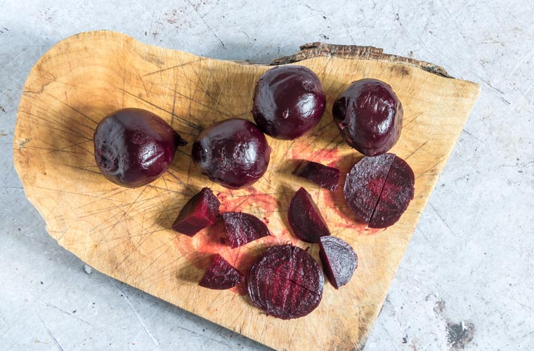 Sliced Cooked beetroot on a chopping board