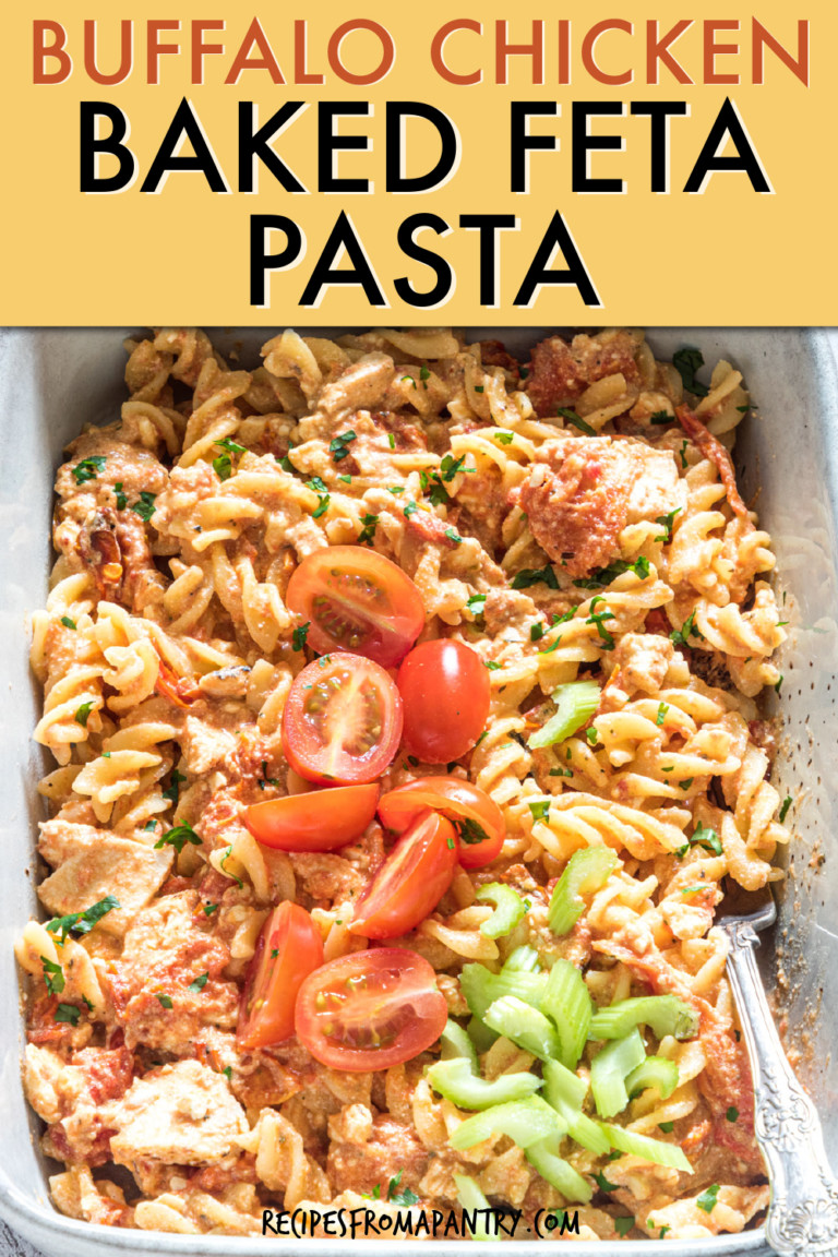BAKED FETA PASTA IN A CASSEROLE DISH GARNISHED WITH TOMATOES