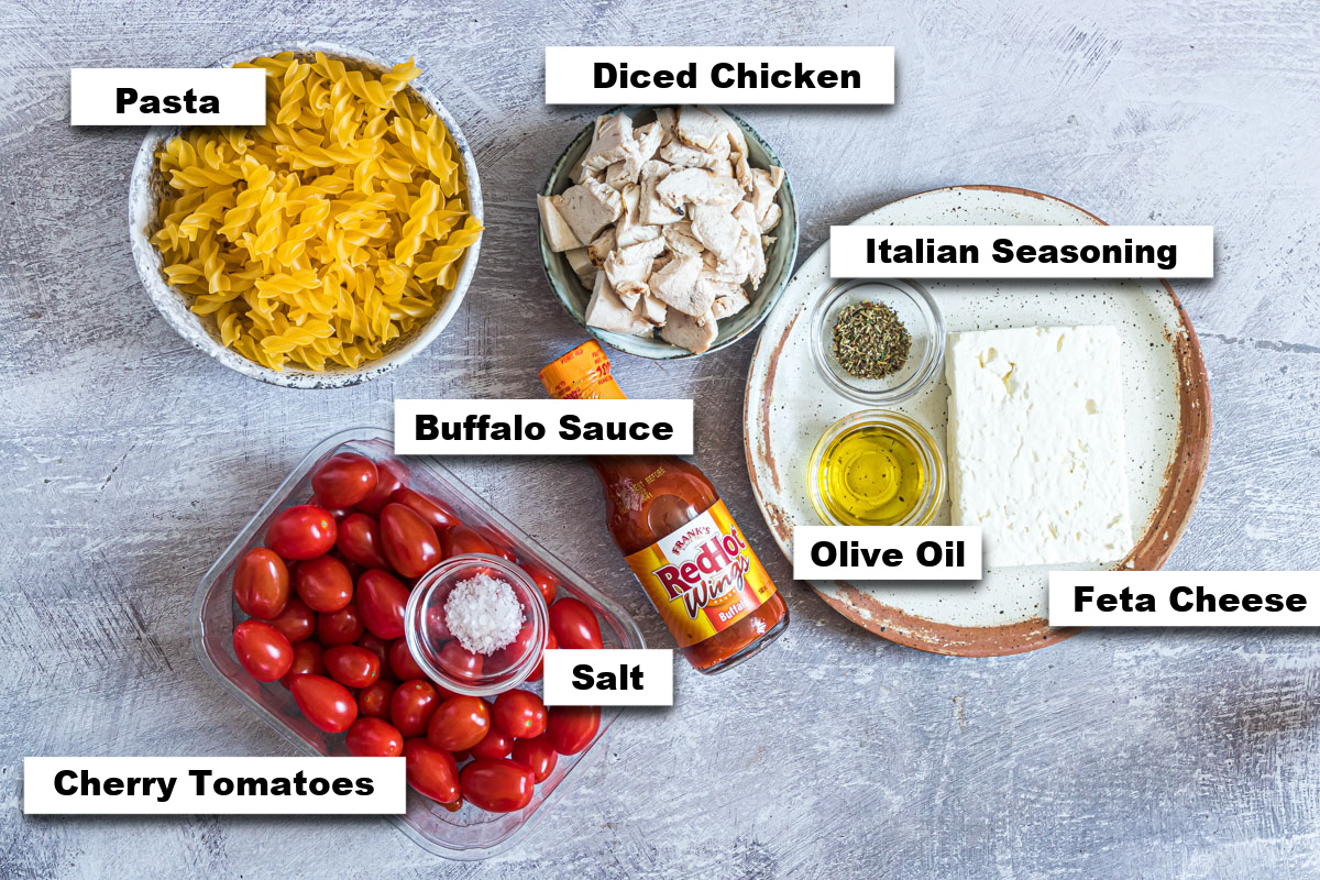 the ingredients needed for making buffalo chicken baked feta pasta