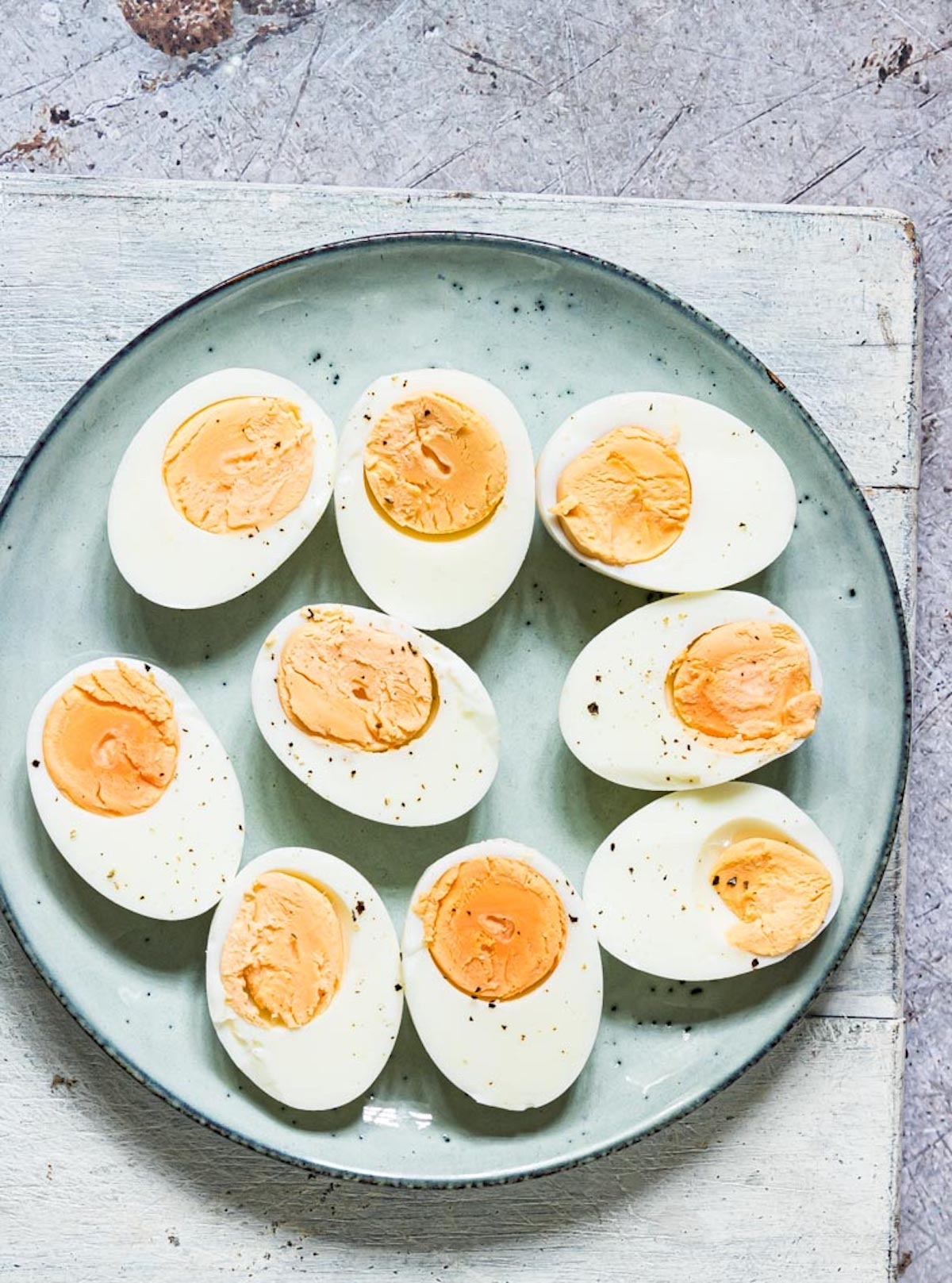 the finished instant pot hard boiled eggs served on a ceramic plate