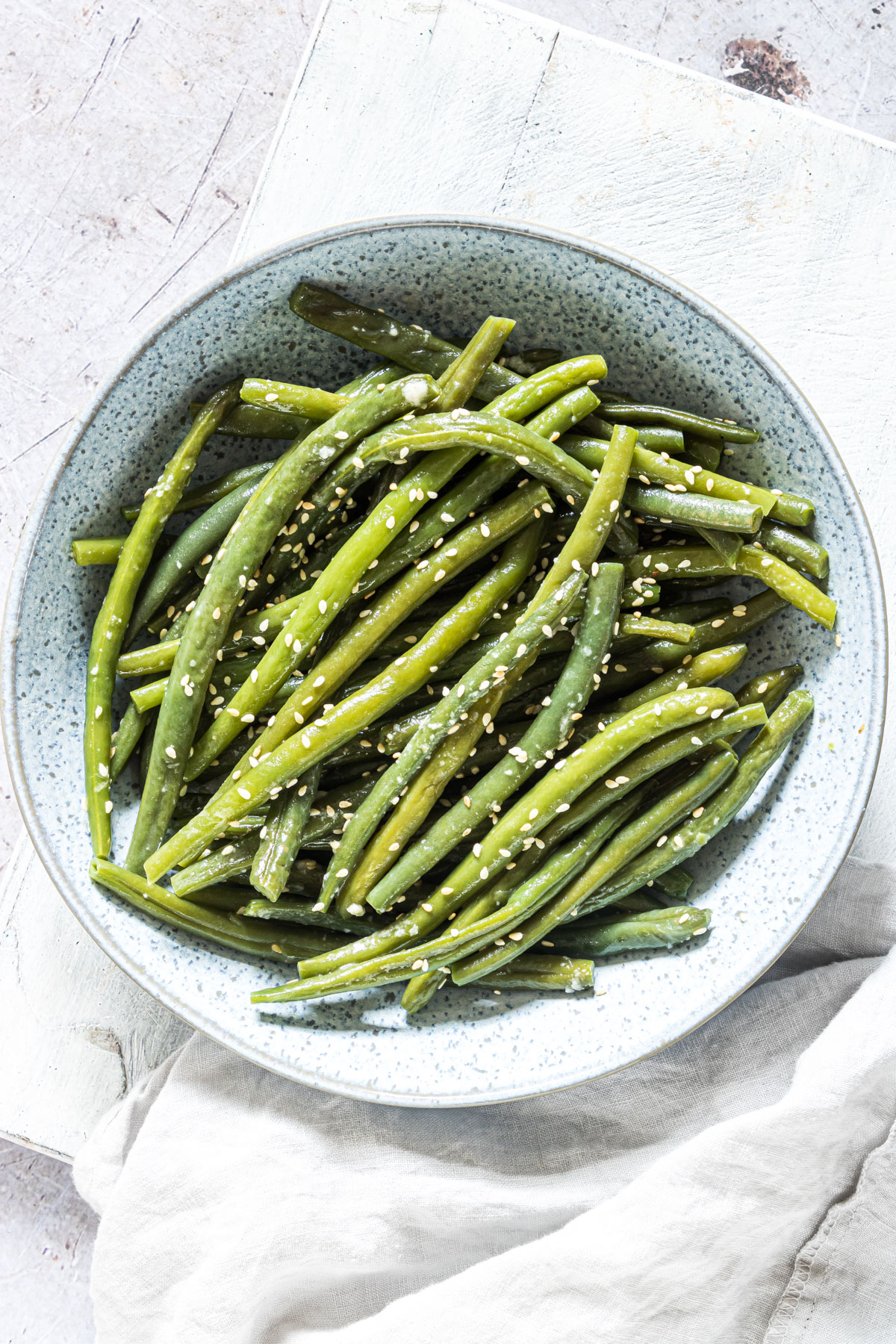 top down view of a serving of instant pot green beans with garlic and butter