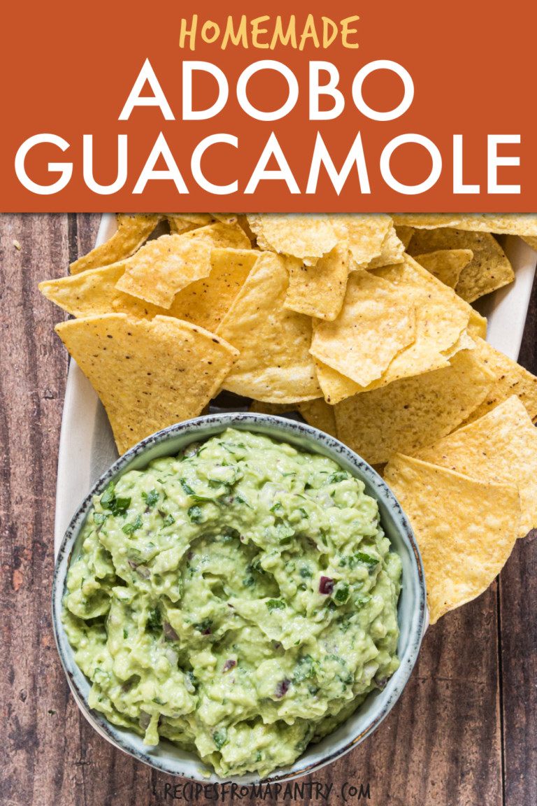 guacamole in a bowl with tortilla chips on the side