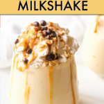 PEANUT BUTTER MILKSHAKE TOPPED WITH WHIPPED CREAM IN A GLASS