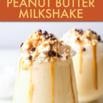 TWO GLASSES OF PEANUT BUTTER MILKSHAKE TOPPED WITH WHIPPED CREAM