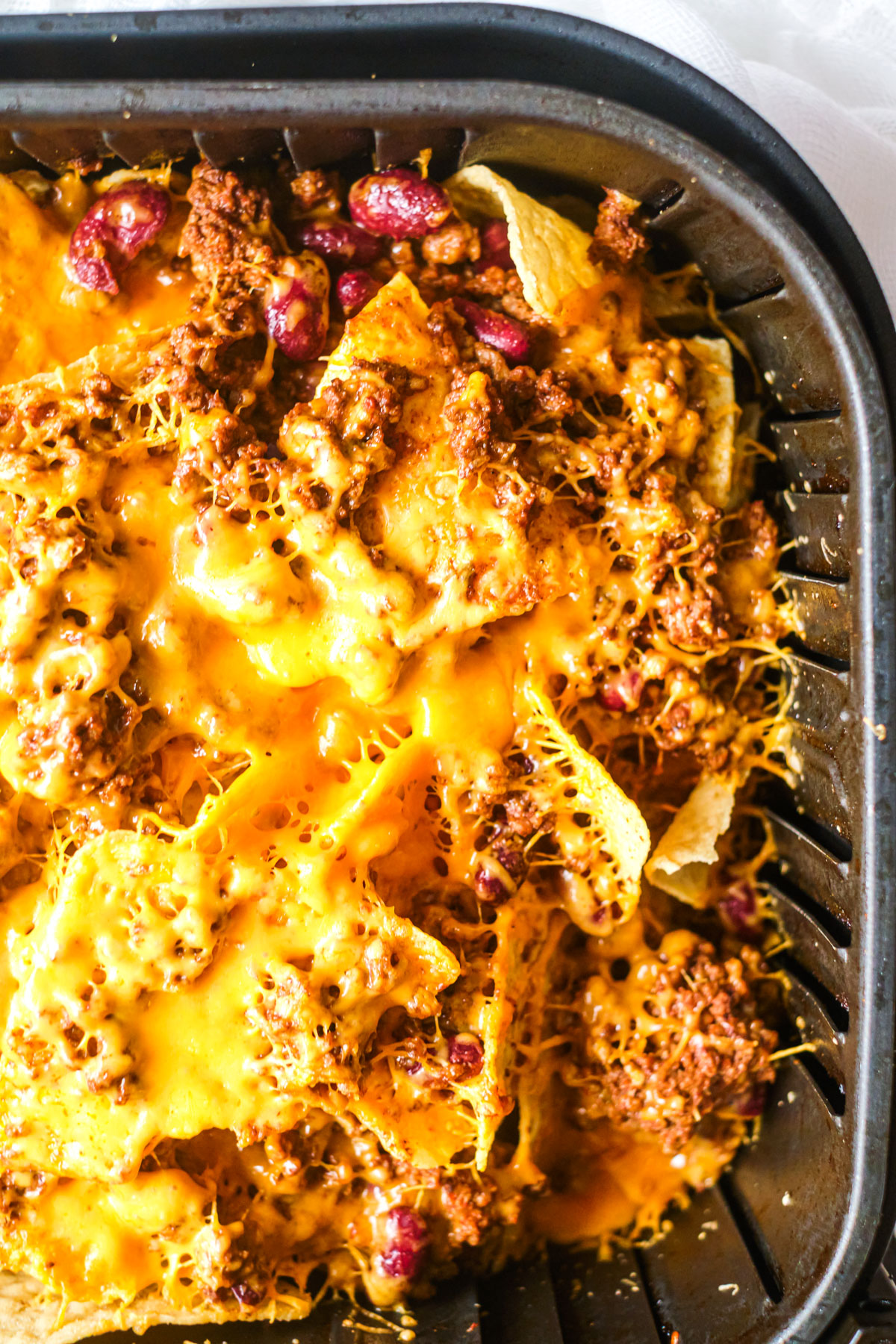 Close up of Air Fryer Nachos With Chili In the air fryer basket