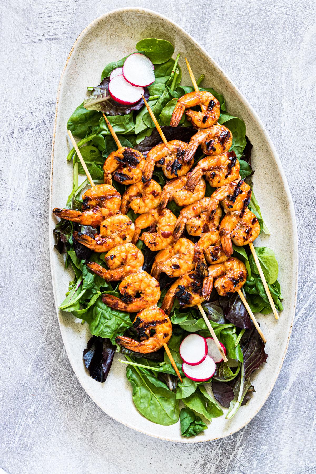 Grilled shrimp kabobs on a salad