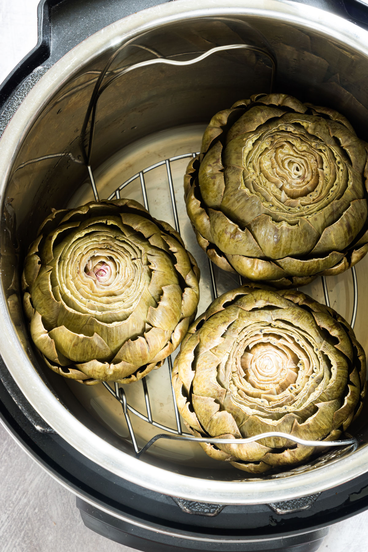 3 cooked artichokes in an instant saucepan