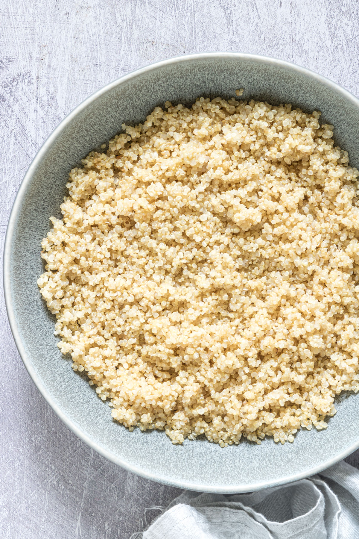 a bowl of cooked quinoa on a table