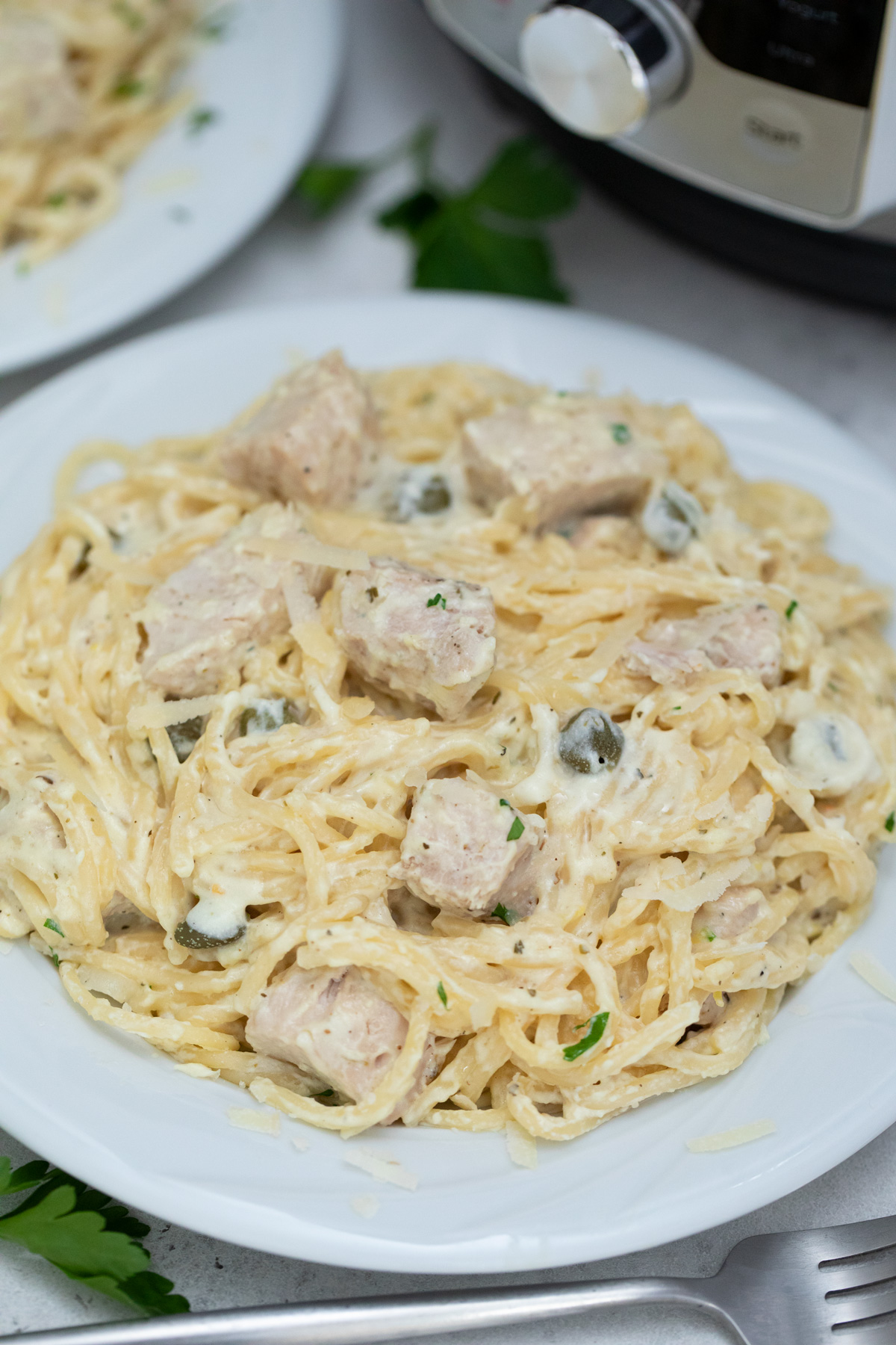 a plate filled with one portion of the instant pot chicken alfredo