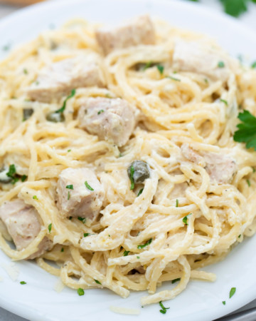 a serving of instant pot chicken alfredo in a white plate