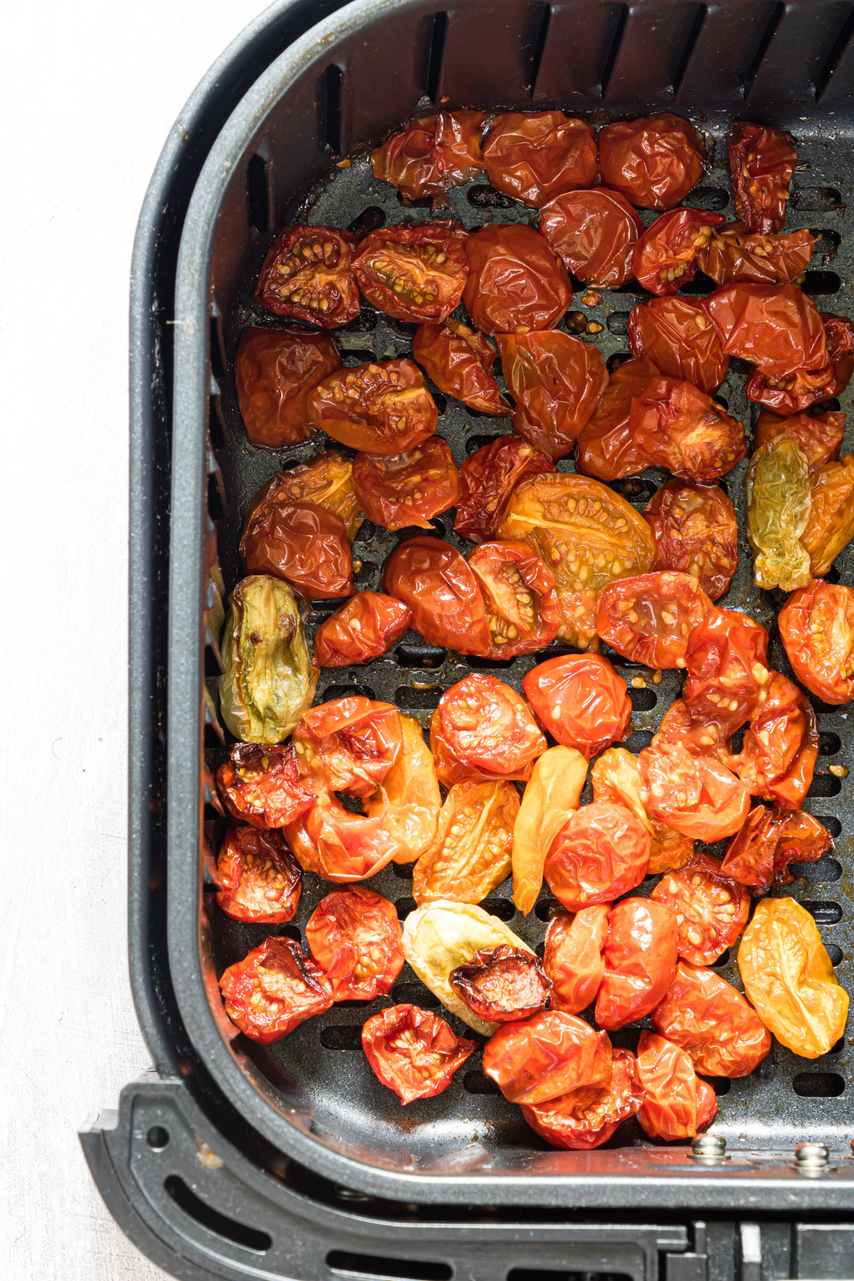 Air fryer slow roasted tomatoes in an an air fryer basket