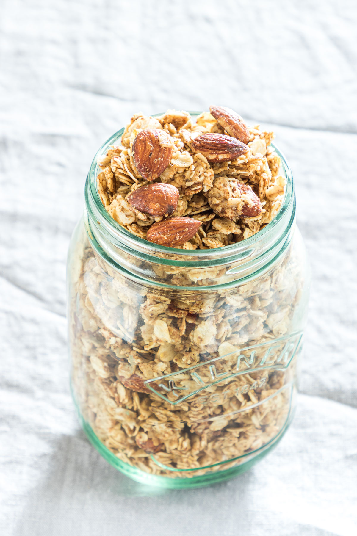 mason jar of cooked almond granola on a table