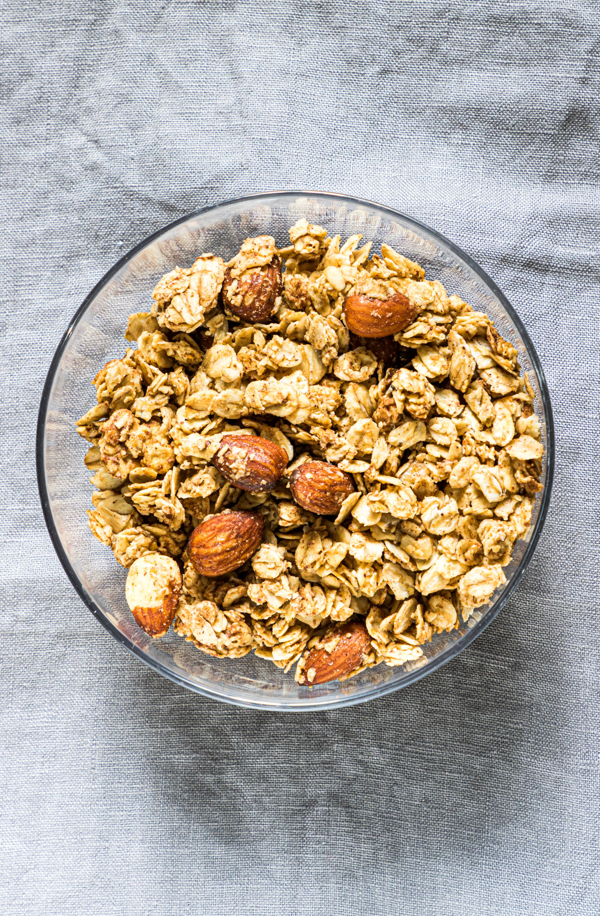 one bowl of almond granola with almonds on a table