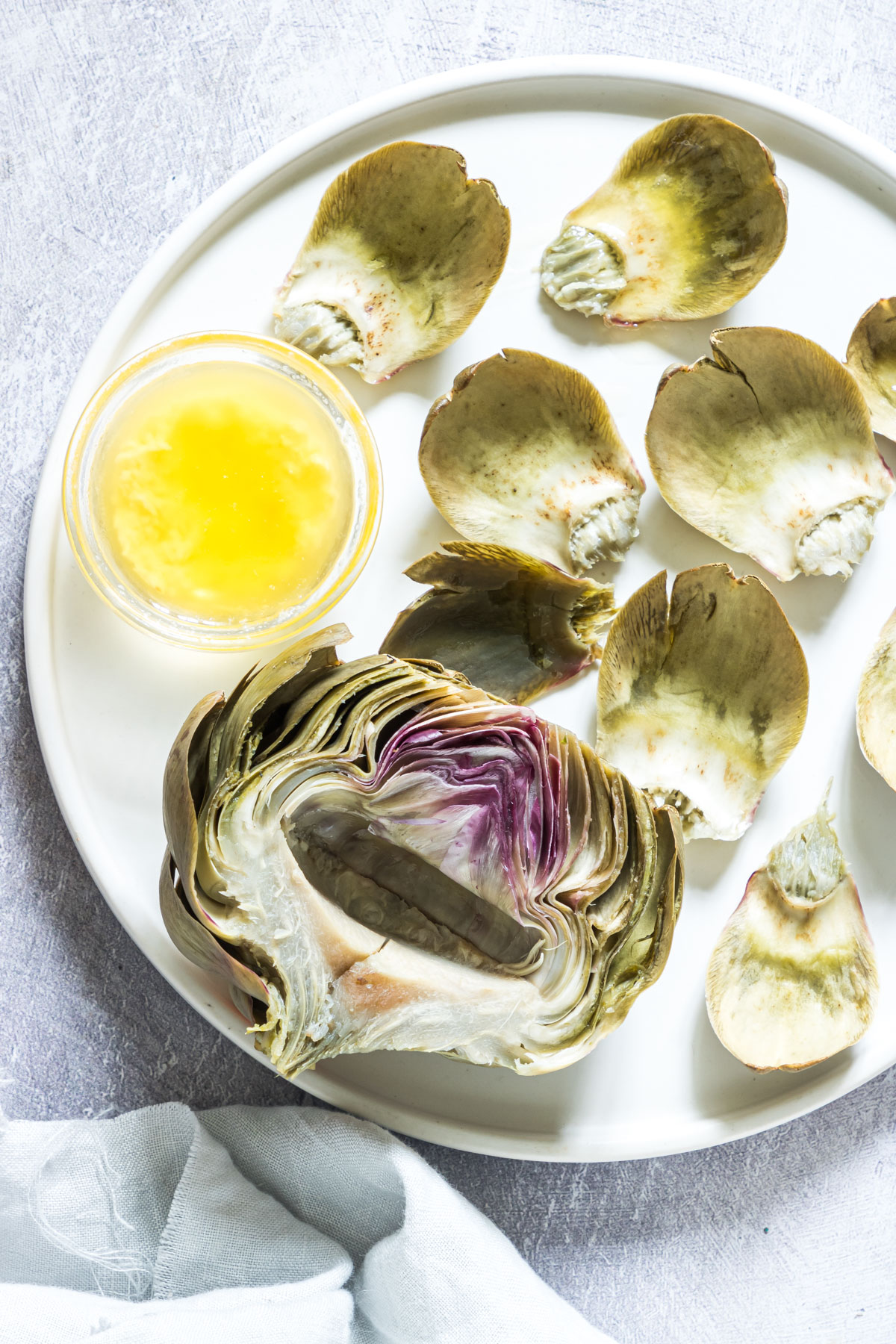 the cooked artichokes cut in half and served with butter sauce