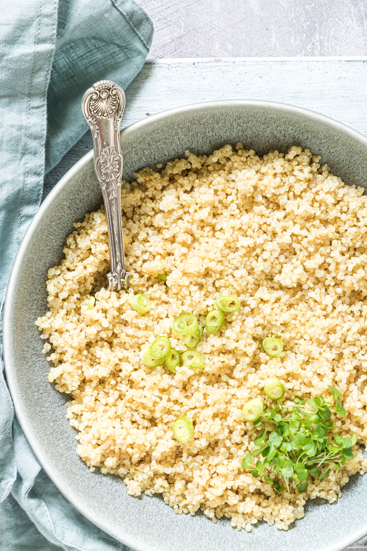 a bowl filled with cooked quinoa in rice cooker